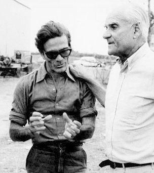 Con Pasolini, uno de sus mejores amigos